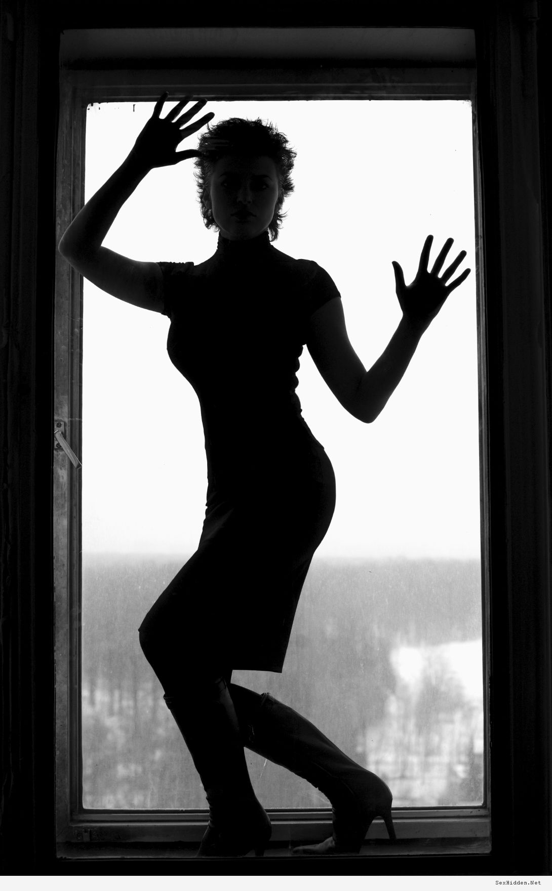 woman silhouette in window